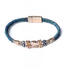 Biba armband facet en disckralen kleur azuur groen met goudaccenten