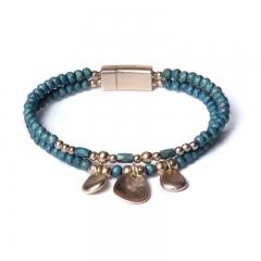 Biba armband facet en ovale bedels kleur azuur groen met goudaccenten