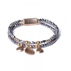 Biba armband facet en ovale bedels kleur donkergrijs met goudaccenten